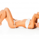 young beautiful woman lies on her back