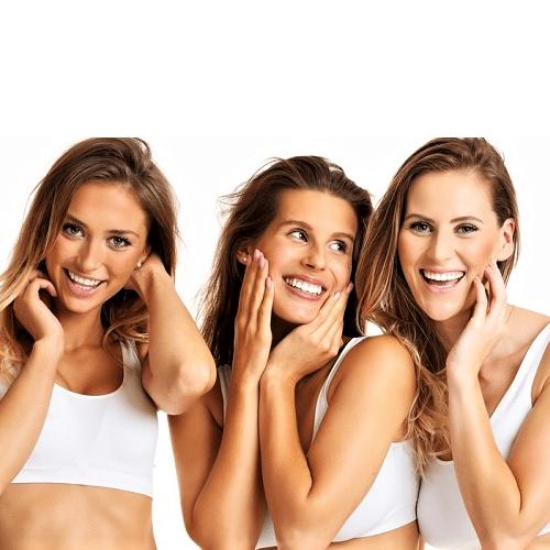 three smiling happy girls